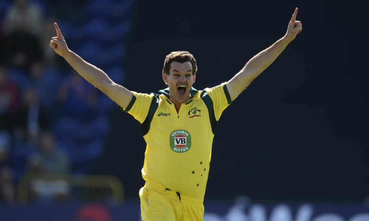Australia's Clint McKay celebrates after achieving a hat-trick after dismissing England's Joe Root during the fourth one-day international at Sophia gardens in Cardiff, Wales September 14, 2013. REUTERS/Philip Brown (BRITAIN - Tags: SPORT CRICKET)