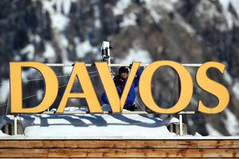 Suspected Russian spies posed as plumbers to bug Davos, report says
