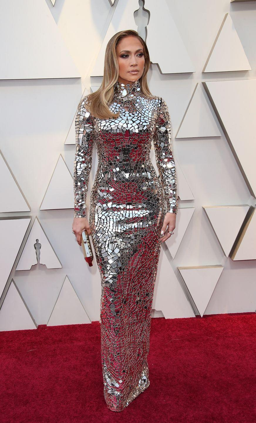 <p>Jennifer Lopez wears a mirrored mosaic gown by Tom Ford.</p>