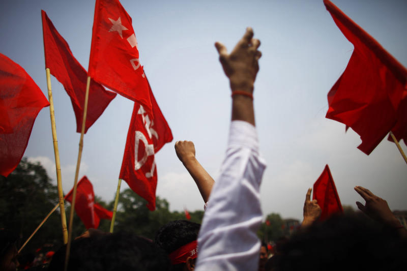 Activists from various trade unions affiliated to the Unified Communist Party of Nepal (Maoist) raise slogans during a rally to mark May Day in Katmandu, Nepal, Tuesday, May 1, 2012. (AP Photo/Niranjan Shrestha)
