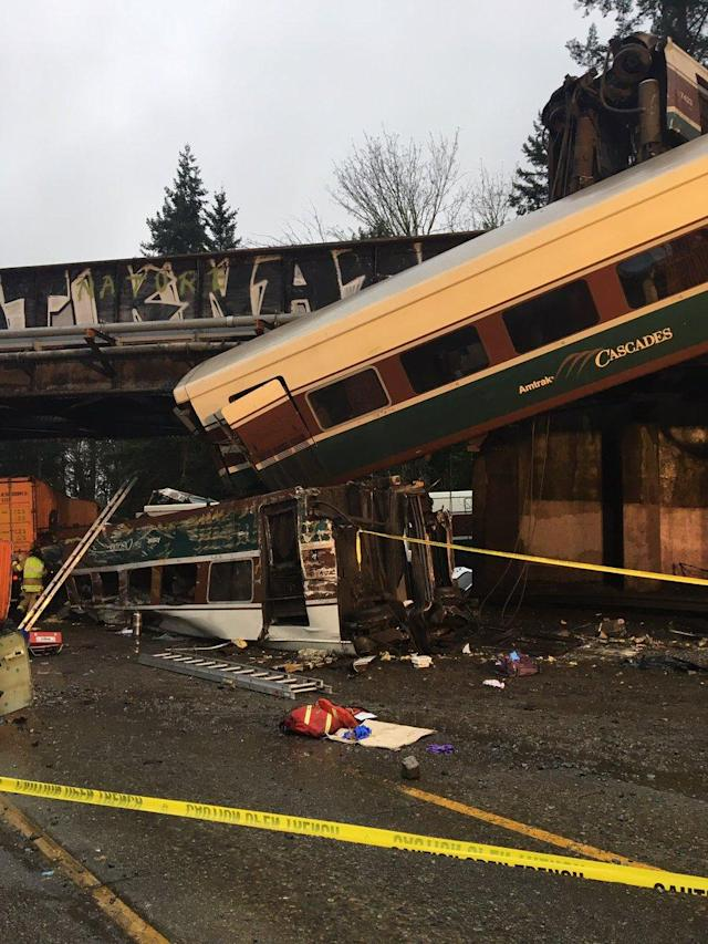 <p>A derailed train falls onto I-5 South in Olympia, WA. (Photo: Trooper Brooke Bova/Wash St. Patrol) </p>