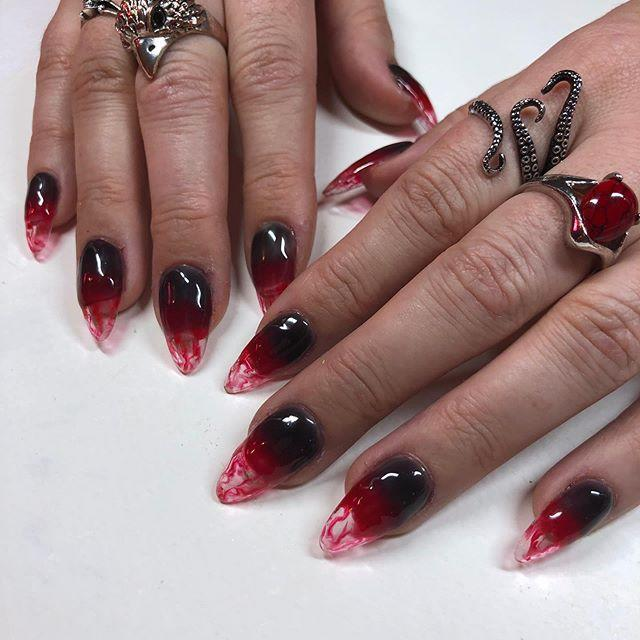 "<p>Your nails will look totally eeevil with this mysterious-looking super-red and acrylic-tipped design. It'l like a pool of of blood! Spooky. </p><p><a href=""https://www.instagram.com/p/B4Bb4FeF7nn/?utm_source=ig_embed&utm_campaign=loading"" rel=""nofollow noopener"" target=""_blank"" data-ylk=""slk:See the original post on Instagram"" class=""link rapid-noclick-resp"">See the original post on Instagram</a></p>"