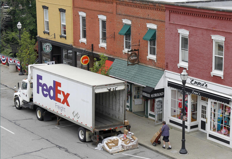 <p> FILE - In this Wednesday, May 23, 2012, file photo, A Federal Express truck makes a delivery in downtown Chagrin Falls, Ohio. FedEx said Tuesday, Dec. 4, 2012, that it will be offering some employees up to two years' pay to leave the company starting next year. The voluntary program is part of an effort by the world's second-biggest package delivery company to cut annual costs by $1.7 billion within three years. (AP Photo/Amy Sancetta, File) </p>