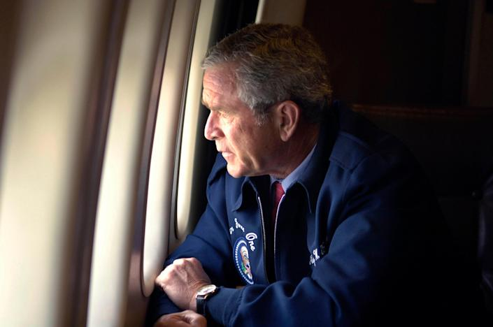 George Bush peers out the window of Air Force One as he surveys Hurricane Katrina damage along the Gulf Coast states of Louisiana, Mississippi and AlabamaREUTERS