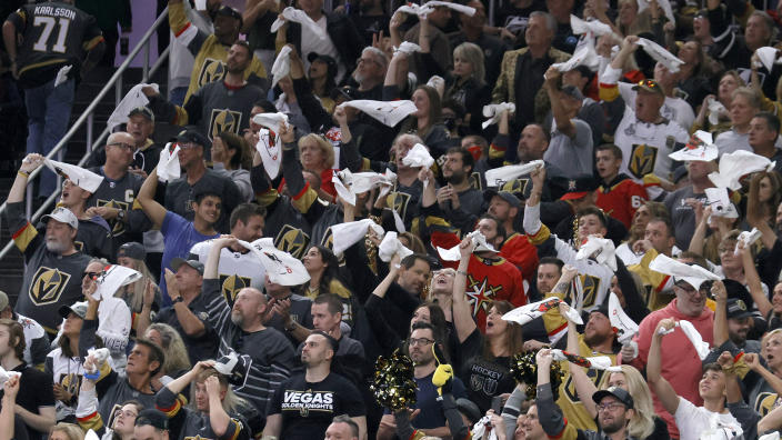 LAS VEGAS, NEVADA - JUNE 10:  Vegas Golden Knights fans celebrate after a first-period goal by William Karlsson #71 of the Golden Knights against the Colorado Avalanche in Game Six of the Second Round of the 2021 Stanley Cup Playoffs at T-Mobile Arena on June 10, 2021 in Las Vegas, Nevada. The Golden Knights defeated the Avalanche 6-3 to win the series.  (Photo by Ethan Miller/Getty Images)