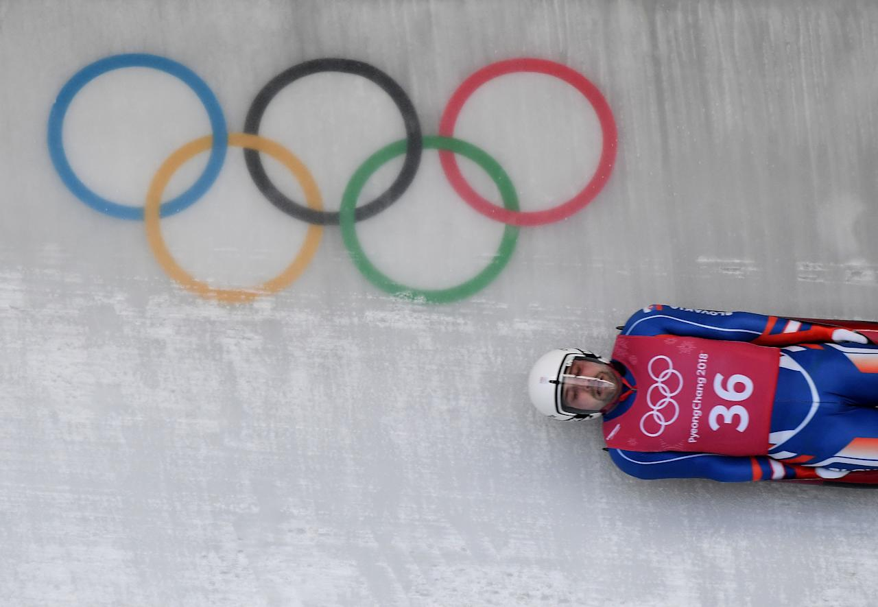 <p>Jozef Ninis of Slovakia takes a corner in a training session for the men's luge singles during the PyeongChang 2018 Winter Olympic Games, at the Olympic Sliding Centre in PyeongChang on February 8, 2018. (Photo credit should read MARK RALSTON/AFP/Getty Images) </p>