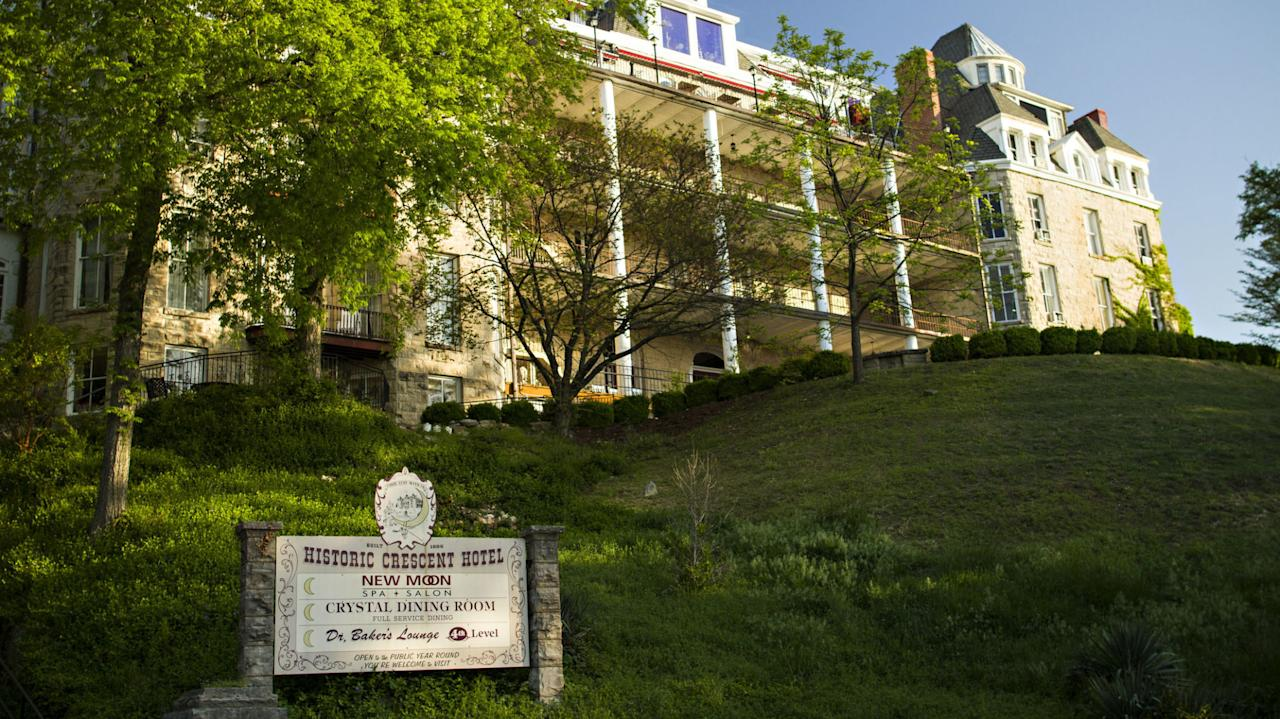 """<p>Spend the night in the haunted<a rel=""""nofollow"""" href=""""http://www.crescent-hotel.com/"""">Crescent Hotel</a>, which opened in 1886 (during construction a worker named Michael was killed, and his ghost still haunts room 218). The hotelcame under theownership of known medical fraud Norman Baker in 1937, who fancied himself a doctor. He turned the hotel into the Baker Cancer Hospital, claimingto have the cure for the disease (he did not, obviously). Patients who died under his care were buried right in the hotel's basement, which served as a makeshift morgue. He was arrested in 1940, but his patients'spirits are said tostill remain. Since the hotel is still open, guests often say they seeapparitions and hear noises during their stays. SyFy's <i>Ghost Hunters</i> even has footage of <a rel=""""nofollow"""" href=""""https://www.youtube.com/watch?v=5T6602FvR1s"""">something moving in the basement</a>.</p>"""
