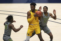 West Virginia forward Derek Culver (1) is defended by Baylor guards Davion Mitchell (45) and Jared Butler (12) during the first half of an NCAA college basketball game Tuesday, March 2, 2021, in Morgantown, W.Va. (AP Photo/Kathleen Batten)
