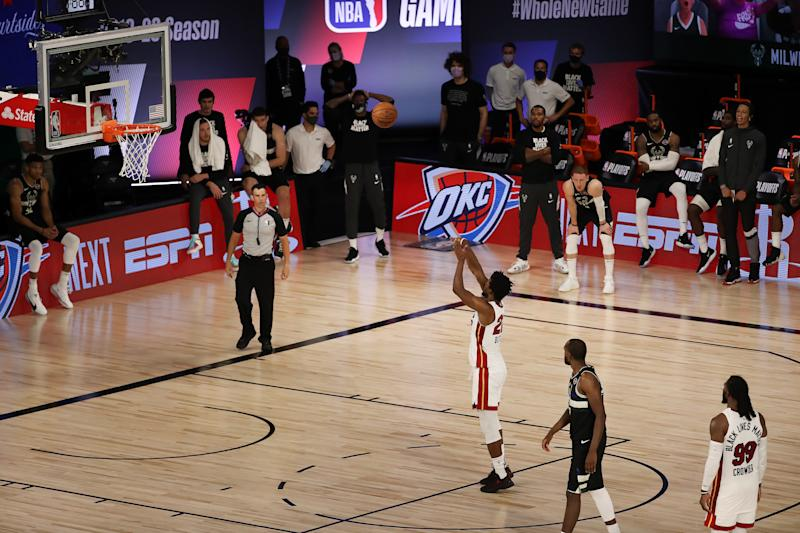 Heat star Jimmy Butler sinks the game-winning free throw with no time on the clock. (Mike Ehrmann/Getty Images)