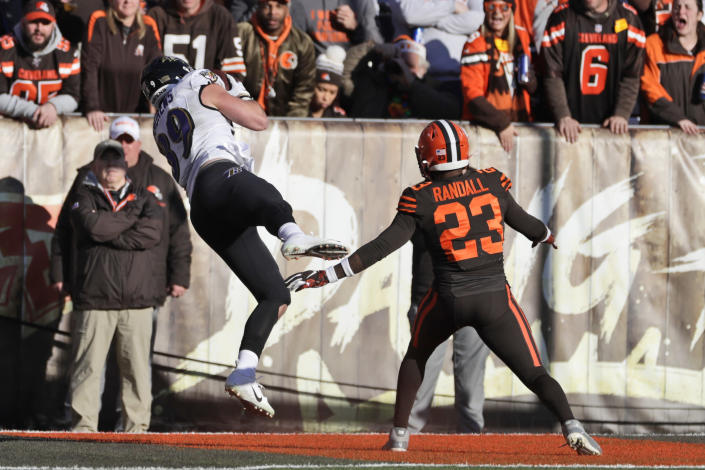 Baltimore Ravens tight end Mark Andrews (89) catches a pass for a 14-yard touchdown as Cleveland Browns strong safety Damarious Randall (23) watches during the first half of an NFL football game, Sunday, Dec. 22, 2019, in Cleveland. (AP Photo/Ron Schwane)
