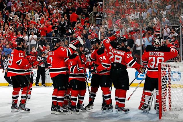 NEWARK, NJ - JUNE 09: The New Jersey Devils celebrate after defeating the Los Angeles Kings during Game Five of the 2012 NHL Stanley Cup Final at the Prudential Center on June 9, 2012 in Newark, New Jersey. (Photo by Bruce Bennett/Getty Images)