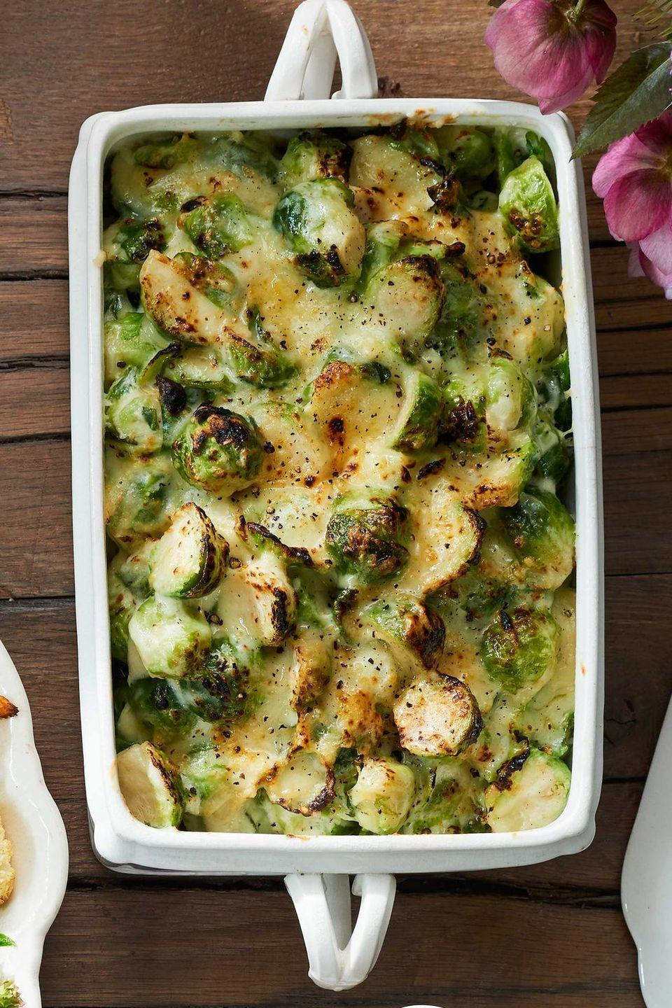"<p>Cheesy, baked Brussels sprouts make a crowd-pleasing holiday side.</p><p><strong><a href=""https://www.countryliving.com/food-drinks/recipes/a40027/brussels-sprouts-gratin/"" rel=""nofollow noopener"" target=""_blank"" data-ylk=""slk:Get the recipe"" class=""link rapid-noclick-resp"">Get the recipe</a>.</strong></p><p><a class=""link rapid-noclick-resp"" href=""https://www.amazon.com/REGALO-HW1224-Rectangular-Stoneware-13-5x8-25x2-5/dp/B07LBT6DHM/?tag=syn-yahoo-20&ascsubtag=%5Bartid%7C10050.g.896%5Bsrc%7Cyahoo-us"" rel=""nofollow noopener"" target=""_blank"" data-ylk=""slk:SHOP BAKING DISHES"">SHOP BAKING DISHES</a></p>"