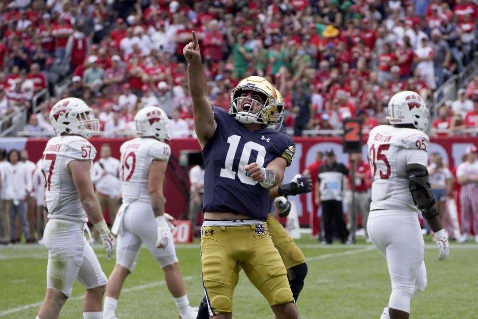 Notre Dame quarterback Drew Pyne celebrates his touchdown pass to wide receiver Kevin Austin Jr. during the second half of an NCAA college football game against Wisconsin Saturday, Sept. 25, 2021, in Chicago. Notre Dame won 41-13. (AP Photo/Charles Rex Arbogast)
