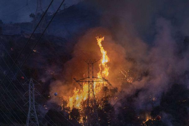 PHOTO: Flames heat up high power lines at the Saddleridge Fire on Oct. 11, 2019 near Newhall, Calif. (David Mcnew/Getty Images, FILE)