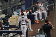 San Francisco Giants center fielder Mauricio Dubon wears a mask before the team's baseball game against the San Diego Padres on Friday, Sept. 11, 2020, in San Diego. Friday night's game was postponed minutes before the scheduled first pitch. No reason was immediately given. (AP Photo/Gregory Bull)