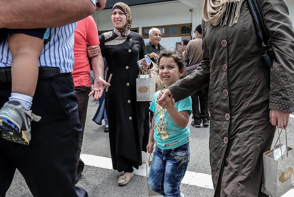 A Syrian migrant family arrives at Subang Air Force base in Subang, outside Kuala Lumpur on May 28, 2016.  Malaysia on May 28 received 68 Syrian refugees including 31 children out of a total of 3,000 it hopes to allow into the predominantly Muslim country with hundreds more expected soon. / AFP / STR / Malaysia OUT        (Photo credit should read STR/AFP/Getty Images)