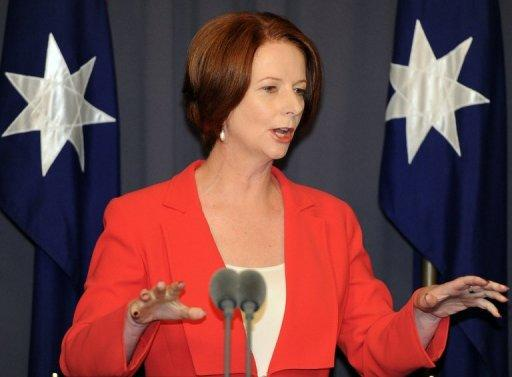 Australian PM Julia Gillard has expressed 'disappointment and concern' over PNG's decision to delay national elections