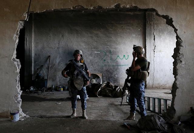 <p>Members of Iraqi Federal Police stand guard at a factory used by Islamic State militants to manufacture home made mortars in western Mosul, Iraq, May 11, 2017. (Photo: Danish Siddiqui/Reuters) </p>