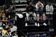 Utah Jazz players watch from the bench during the second half of an NBA basketball game against the Phoenix Suns, Friday, April 30, 2021, in Phoenix. (AP Photo/Matt York)