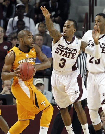 Mississippi State guard Dee Bost (3) attempts to block a pass by Tennessee guard Trae Golden, left, in the first half of their NCAA college basketball game in Starkville, Miss., Thursday, Jan. 12, 2012. (AP Photo/Rogelio V. Solis)