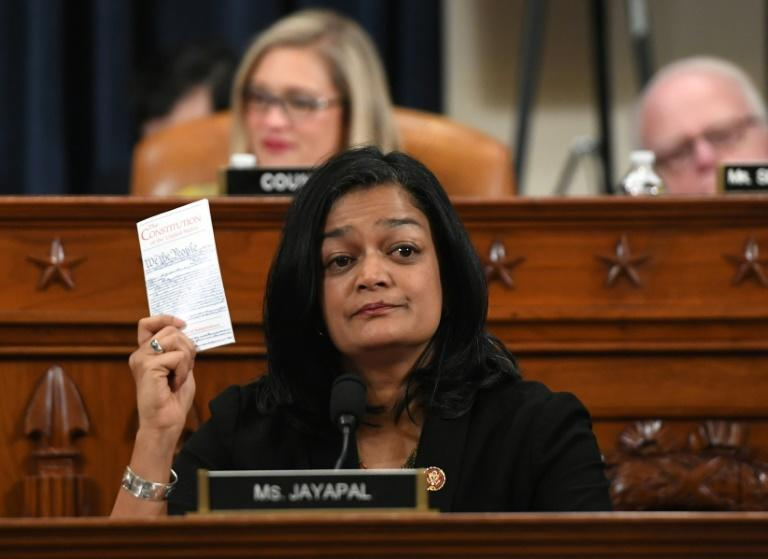 Democratic lawmaker Pramila Jayapal holds up a copy of the Constitution as she votes to impeach President Donald Trump (AFP Photo/SAUL LOEB)