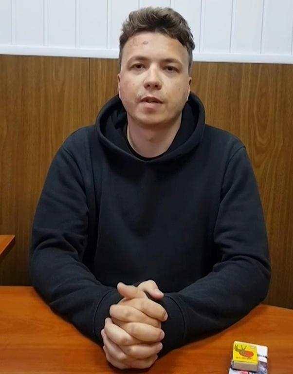 In this screengrab taken from an undated video made available by anonymously-sourced Telegram channel Nevolf and shared on social media and the Belarus State TV, activist Roman Protasevich sits at a table in the detention House Numero 1 in Minsk
