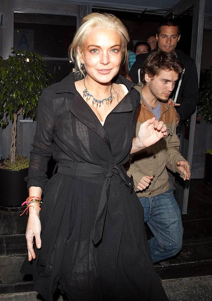 """Lindsay Lohan appeared a bit haggard (I'm being generous) upon exiting the Lexington Social Club in Hollywood on Wednesday night, just one day after her 35-day house arrest for jewelry theft ended. Do you think the former """"Mean Girls"""" star will ever regain her career ... or her looks? SPW/<a href=""""http://www.splashnewsonline.com"""" target=""""new"""">Splash News</a> - June 29, 2011"""