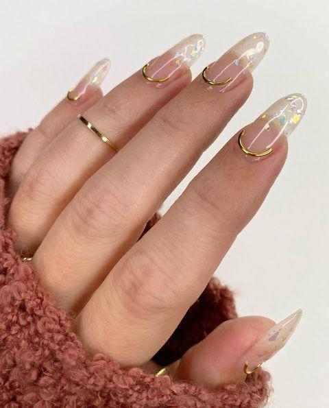 "<p>Or try gilding your cuticles with gold à la Brittney Boyce.</p><p><a href=""https://www.instagram.com/p/CFcfZVnjH0O/"" rel=""nofollow noopener"" target=""_blank"" data-ylk=""slk:See the original post on Instagram"" class=""link rapid-noclick-resp"">See the original post on Instagram</a></p>"