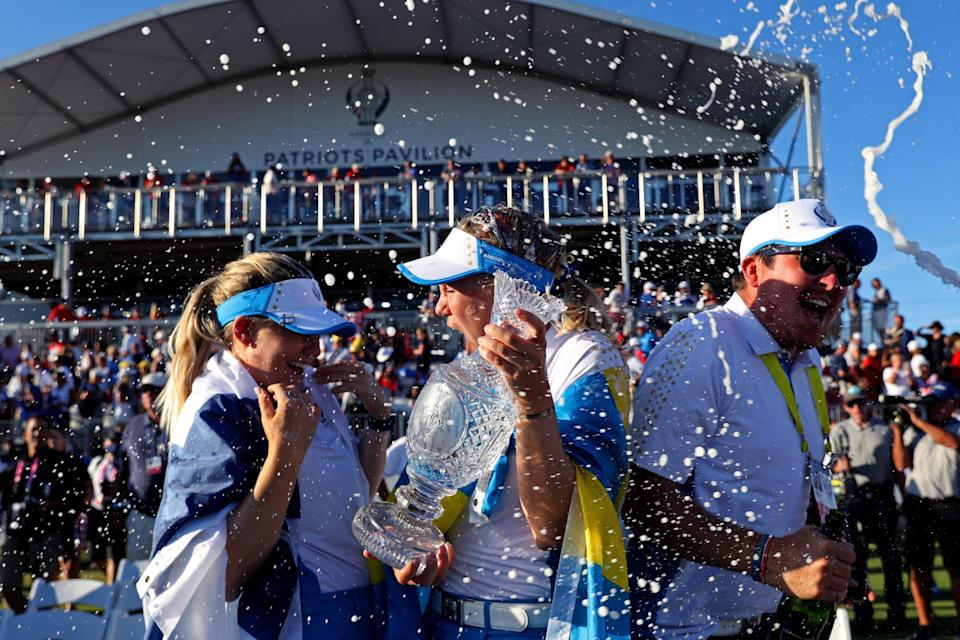 Team Europe stars Matilda Castren and Madelene Sagstrom celebrate with the Solheim Cup after beating Team USA in the event.