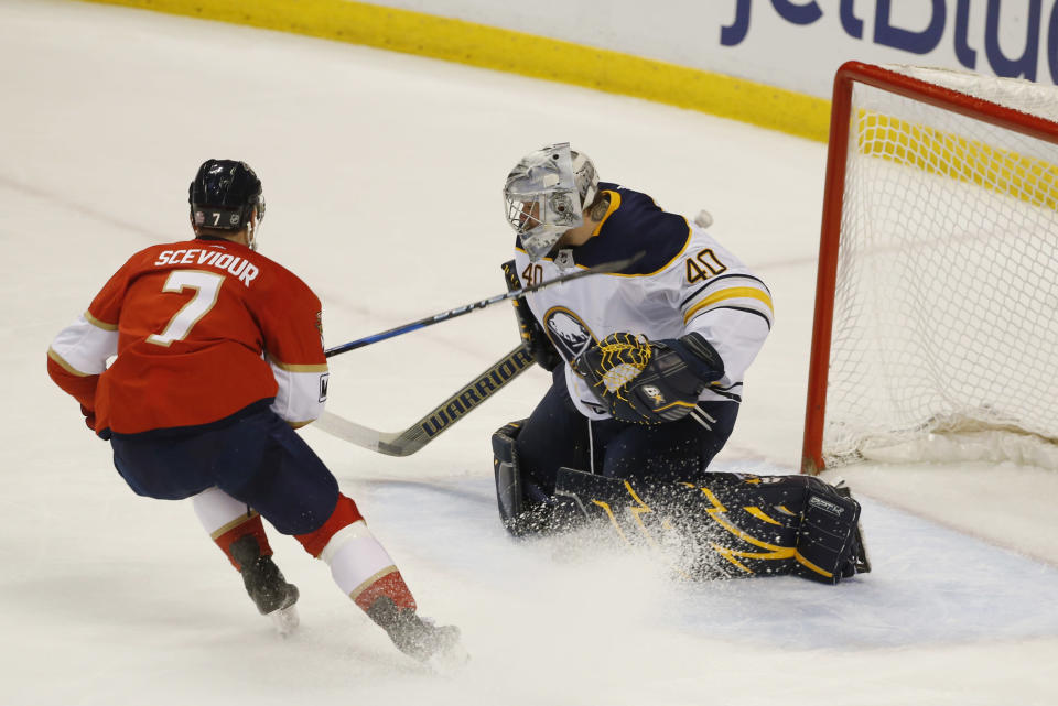 Florida Panthers center Colton Sceviour (7) attempts a shot at Buffalo Sabres goaltender Robin Lehner (40) during the second period of an NHL hockey game, Friday, March 2, 2018, in Sunrise, Fla. (AP Photo/Wilfredo Lee)