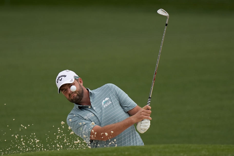 Marc Leishman, of Australia, hits out of a bunker on the second hole during the second round of the Masters golf tournament on Friday, April 9, 2021, in Augusta, Ga. (AP Photo/David J. Phillip)