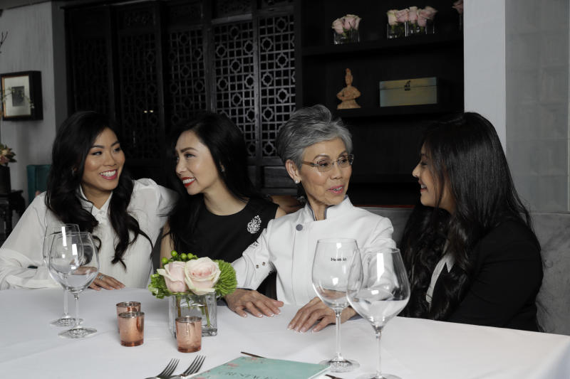 CORRECTS SPELLING OF NAME TO BOSILIKA NOT BASILIKA - From left, members of the An family, Catherine, Elizabeth, Helene and Bosilika pose for a photo at the family's restaurant Crustacean Beverly Hills Monday, May 13, 2019, in Beverly Hills, Calif. On May 18, the Smithsonian Asian Pacific American Center launches a $25 million fundraising drive for permanent gallery space on the National Mall in Washington, D.C. with a glitzy party in Los Angeles full of celebrities and politicians. (AP Photo/Marcio Jose Sanchez)