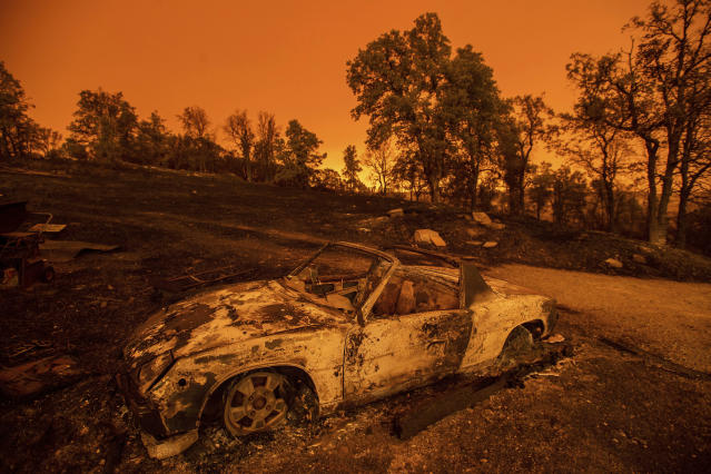 <p>Cars scorched by the Carr Fire rest at a residence in Redding, Calif., on July 27, 2018. (Photo: Noah Berger/AP) </p>