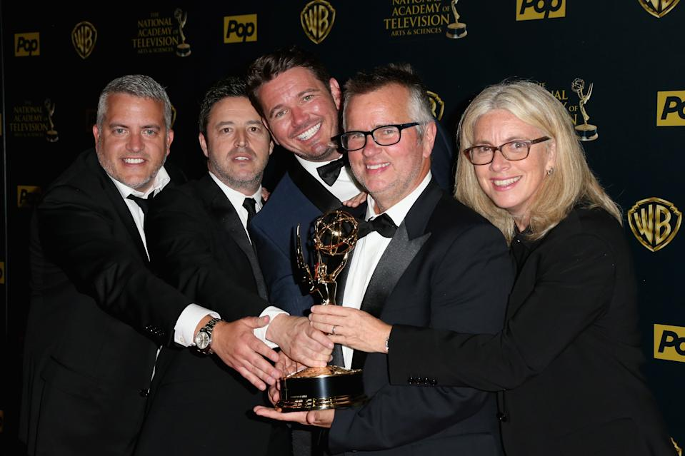 """""""Ellen"""" producers Jonathan Norman, Andy Lassner, Kevin Leman, Ed Glavin and Mary Connelly with the Emmy for Outstanding Talk Show Entertainment in 2015. (Frederick M. Brown/Getty Images)"""