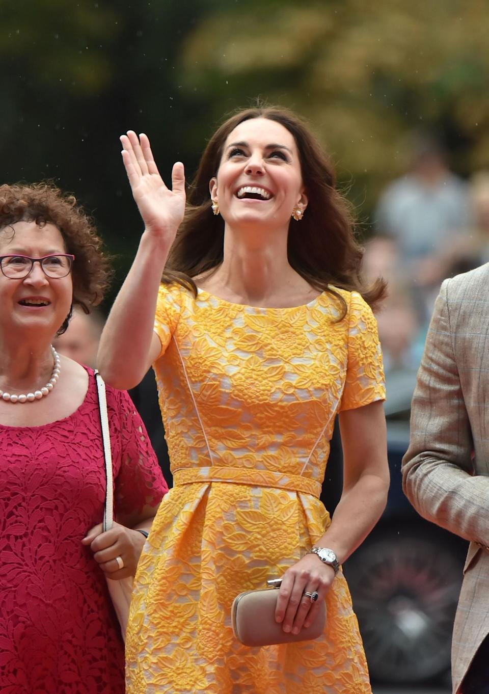 <p><b><b><b>The royals were faced with yet more joyous crowds as they arrived at a German Cancer Research Institute in Heidelberg on day four of their tour. For the occasion, the Duchess wore a lemon yellow Jenny Packham dress – which considerably brightened up the dreamy weather. <em>[Photo: PA]</em> </b></b></b></p>