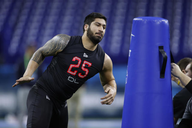 Iowa EDGE A.J. Epenesa could slide ... right to the New England Patriots. (Photo by Joe Robbins/Getty Images)