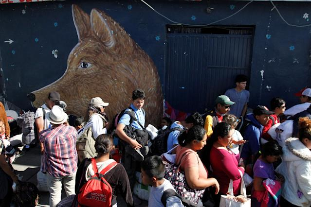 Central American migrants, moving in a caravan through Mexico and traveling to request asylum in the U.S., wait in line to enter the Juventus 2000 shelter after arriving to Tijuana, Mexico April 24, 2018. REUTERS/Jorge Duenes