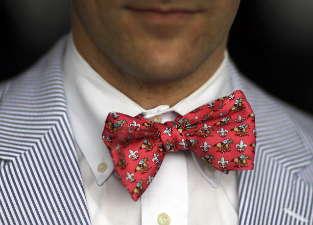 Spectator Bill Norris sports a horse-themed bow tie at Pimlico Race Course in Baltimore, Saturday, May 18, 2013, before the 138th running of the Preakness Stakes horse race. (AP Photo/Patrick Semansky)