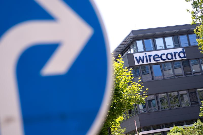 The Wirecard logo can be seen at the headquarters of the payment service provider on June 24, 2020, Bavaria, Aschheim. In front of it there is a traffic sign. (Photo: Sven Hoppe/picture alliance via Getty Images)