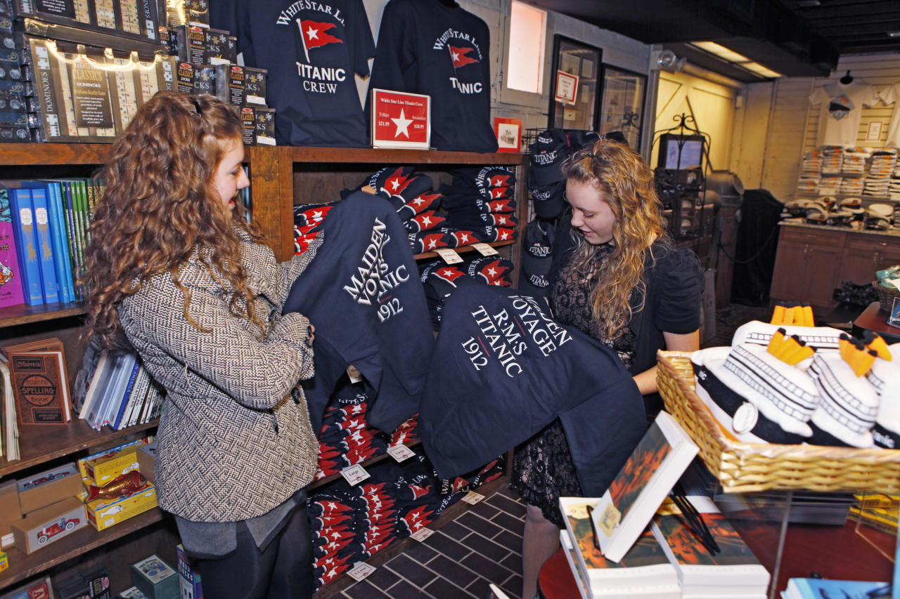 "In this March 2, 2012 photo, Julia Brito, left, and Lacee Amack look at shirts at the gift shop at the Molly Brown House Museum in Denver. A few blocks from Colorado's state Capitol _ over 1700 miles from the Atlantic Ocean and a mile above sea level _ is a museum dedicated to a woman eclipsed by legend following the sinking of the Titantic. The ""unsinkable Molly Brown"" moved into this stone Victorian home after she and her husband struck it rich at a gold mine in Colorado's mountains, nearly 20 years before she boarded the Titanic because it was the first boat she could get back home to visit her ailing grandson. (AP Photo/Ed Andrieski)"