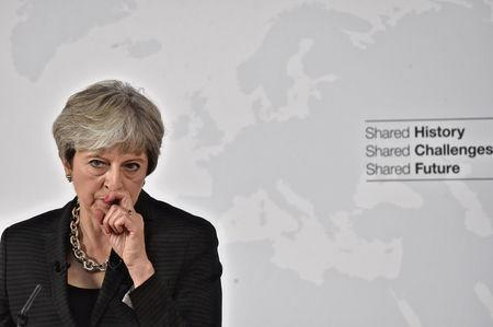 British Prime Minister May gestures as she delivers her speech in Florence