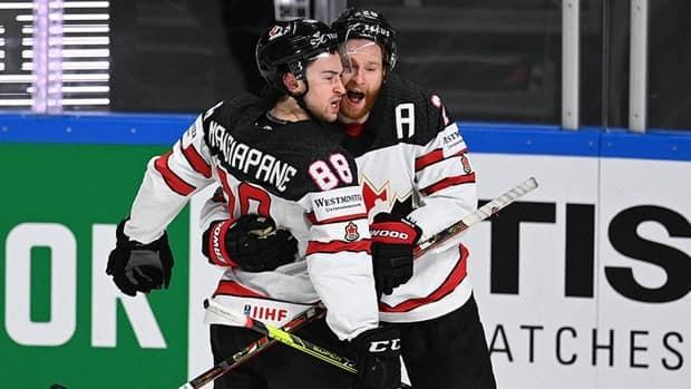 Canada's Andrew Mangiapane, left, celebrates one of his two goals with teammate Connor Brown in Saturday's 4-2 semifinal win over the United States at the world hockey championship in Riga, Latvia.