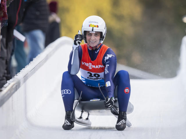 Third placed Andrea Voetter from Italy celebrates as she crosses the finish line of the women's single luge second heat race at the Luge World Cup in Altenberg, Germany, Sunday, Jan. 12, 2020. (Matthias Rietschel/dpa via AP)
