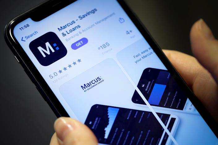 A woman looks at Marcus, a new savings and loans app recently launched by Goldman Sachs in New York, U.S., January 10, 2020. REUTERS/Mike Segar