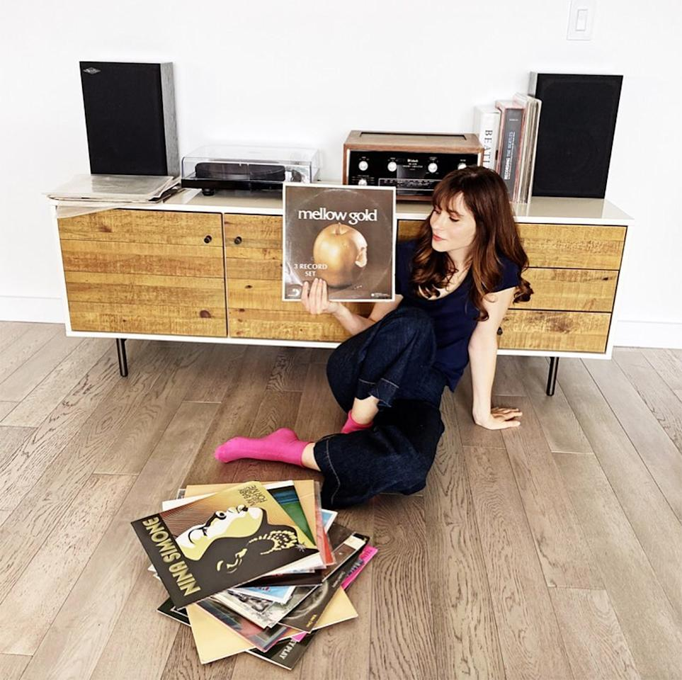 "<p>The <em>New Girl</em> star showed off some of her favorite ""chill records"" she recommends for social distancing at home. ""Cheers in isolation!"" <a href=""https://www.instagram.com/p/B-aAi0mnFQc/"">she wrote</a>. </p>"