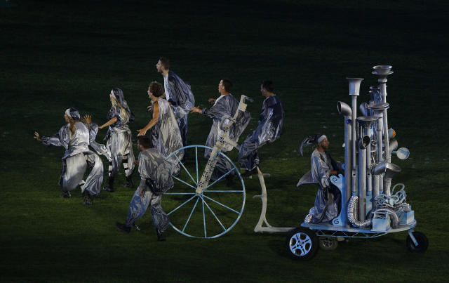 Performers arrive in the Olympic Stadium on top of strange sculptured vehicles are seen during the closing ceremony for the 2012 Paralympics games, Sunday, Sept. 9, 2012, in London. (AP Photo/Kirsty Wigglesworth)