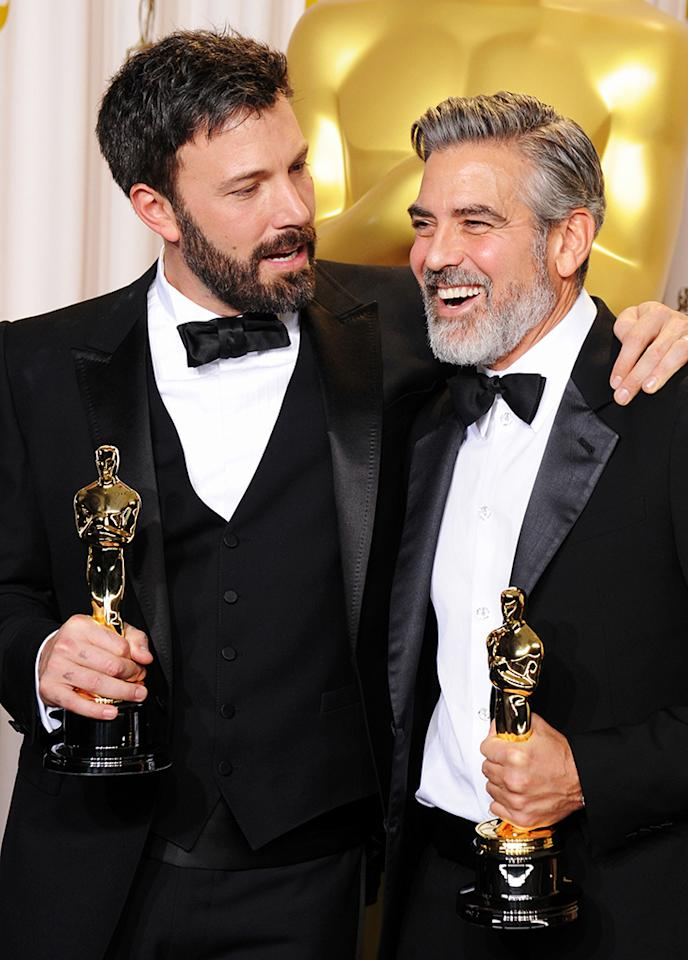 Ben Affleck (L) and George Clooney pose in the press room during the Oscars at the Loews Hollywood Hotel on February 24, 2013 in Hollywood, California.
