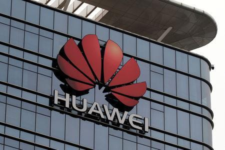 FILE PHOTO: The Huawei logo is pictured outside its Huawei's factory campus in Dongguan, Guangdong province, China, March 25, 2019. REUTERS/Tyrone Siu/File Photo