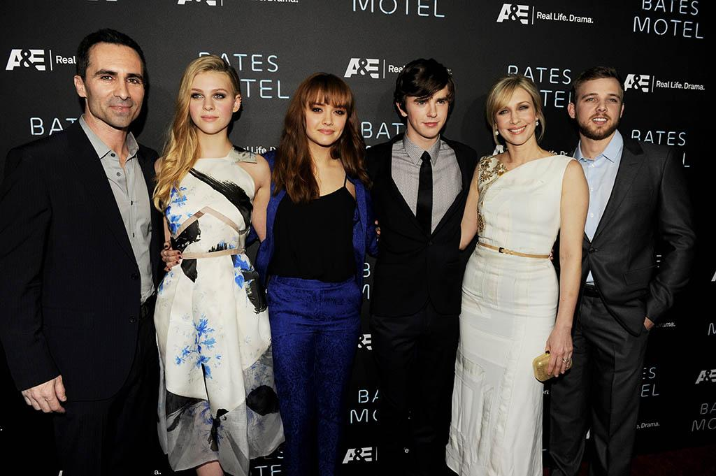 "Nestor Carbonell, Nicola Peltz, Olivia Cooke, Freddie Highmore, Vera Farmiga and Max Thieriot arrive at the premiere of A&E Network's ""Bates Motel"" at Soho House on March 12, 2013 in West Hollywood, California."