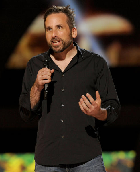 """FILE - In this Dec. 7, 2012 file photo, Ken Levine, creative director and co-founder of Irrational Games, presents the world premiere of """"BioShock Infinite"""" on stage at Spike's 10th Annual Video Game Awards at Sony Studios, in Culver City, Calif. Levine is hoping the companion character, Elizabeth, provides a new depth to """"Infinite,"""" one that wasn't reached in the original """"BioShock,"""" whose voiceless protagonist didn't have a sidekick. It's been a daring and daunting endeavor for the game's makers, especially considering Elizabeth was originally envisioned as a completely mute and scripted character. (Photo by Chris Pizzello/Invision/AP, File)"""
